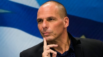 Newly appointed Greek Finance Minister Varoufakis attends a hand over ceremony in Athens